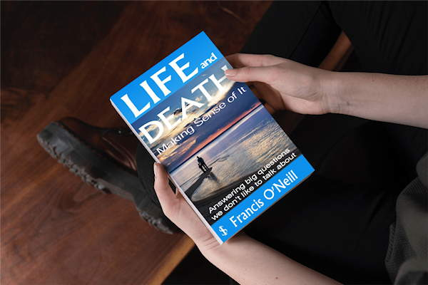 Life and Death book | guy holding book image