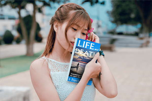 Book Reviews on Life and Death Making Sense of It | Japanese lady holding book image