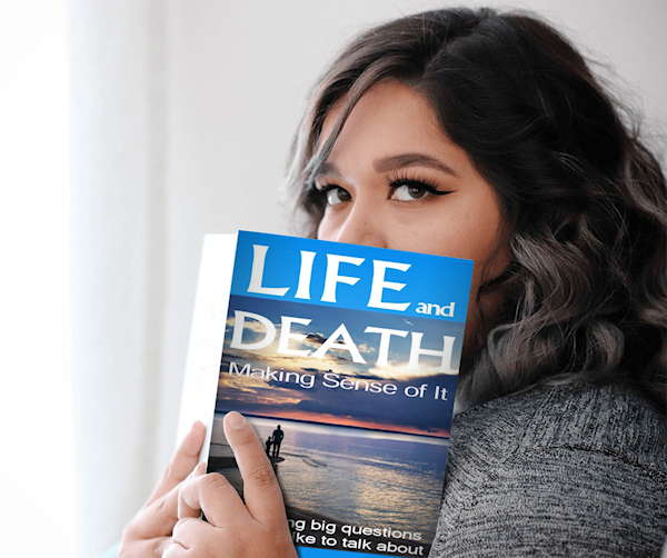 Life and Death: Making Sense of It | lady holding book image